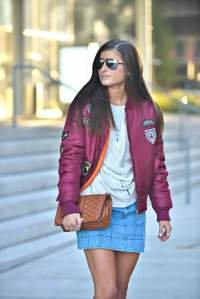 Wearing cream knit top with patched bomber